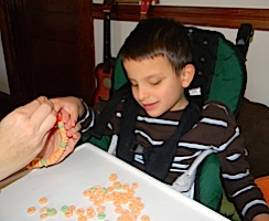 Ivan decorating our Christmas tree brownies