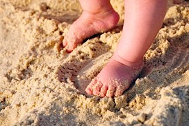 Baby feet in sand