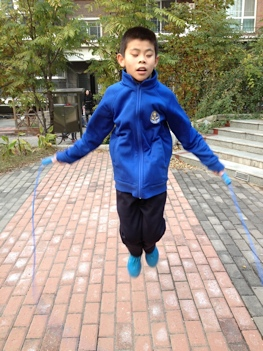 Young boy skipping rope