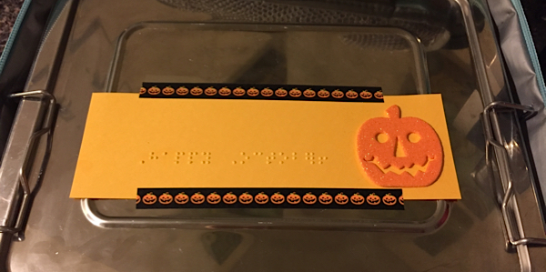 A braille note saying Happy October