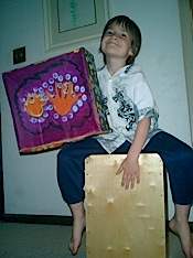 A boy playing his cajon