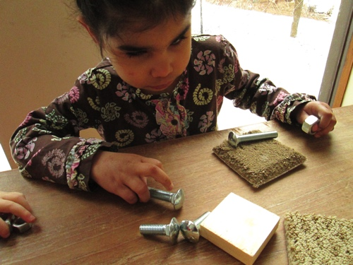 Anelia touching nuts and bolts.