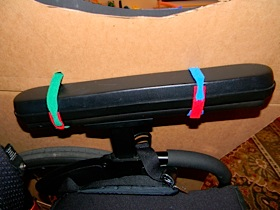attaching the horse to the wheelchair with velcro ties