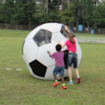 playing with a huge soccer ball