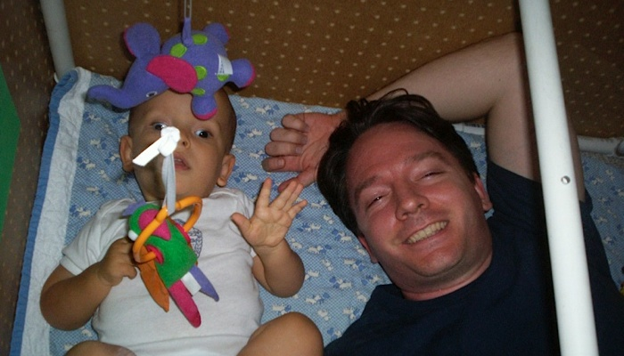 Ivan with his dad in his sensory play area