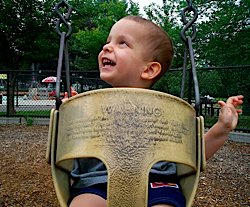 Ivan swinging at the park