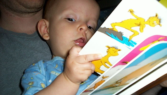 Ivan reading a baby book