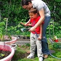 Ivan watering the garden