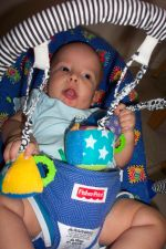 Ivan playing with hanging toys