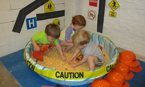 Kids playing in a large sensory bin