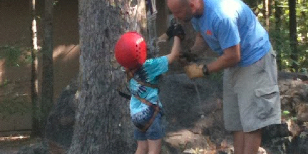 climbing a rope at camp