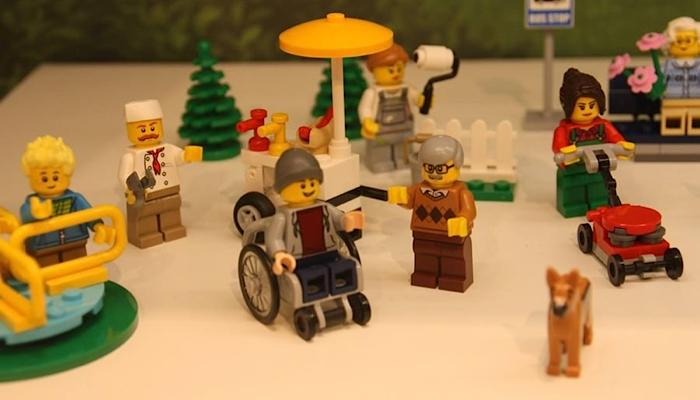 LEGO play set featuring a boy in a wheelchair