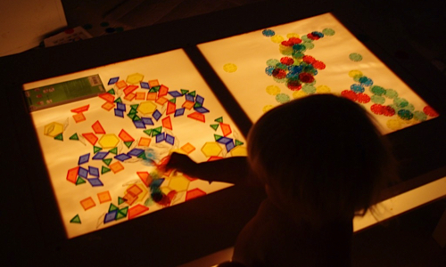 playing at a light table
