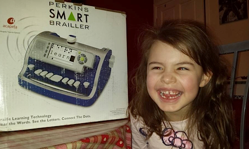 Lily Grace with the SMART Brailler box