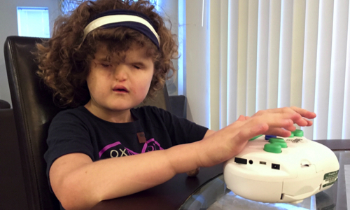 Madilyn using the 6dot braille label maker