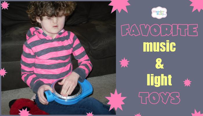 Girl in pink striped shirt playing blue handheld game.