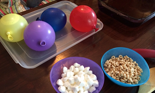 things you'll need for your snow table: water balloons, warm water, spoons, marshmallows, cheerios