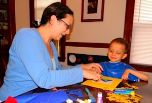 Ivan and mom at the art table