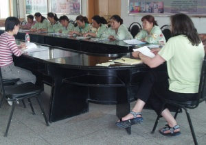 A meeting of ccupational therapists who work with children in a Chinese orphanage