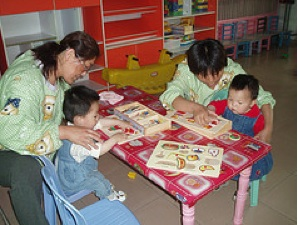 Occupational therapists working with children in a Chinese orphanage