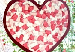 Tissue paper heart suncatcher hanging in the window