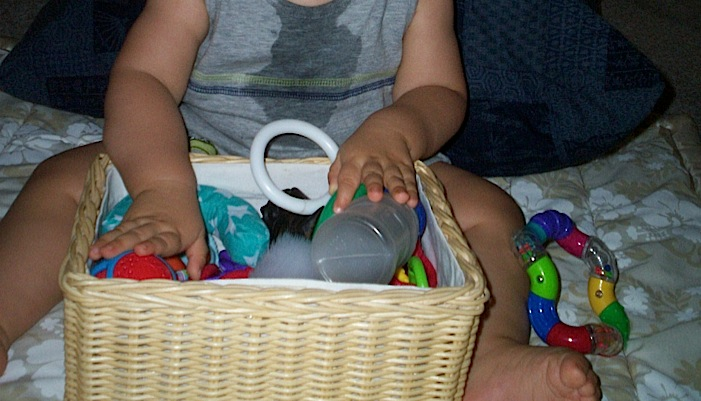 Ivan playing with his toy basket