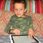 Ivan playing on his iPad
