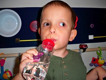 Ivan drinking from his sippy cup