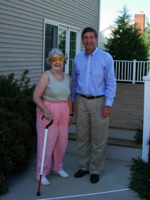 Ed standing in front of the house with his mom, Jane