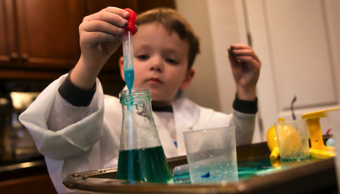 a young boy doing chemistry